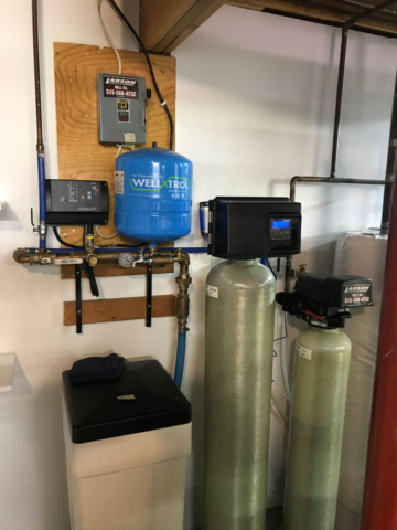 Colored photo of water softener, iron filter and buffer tank