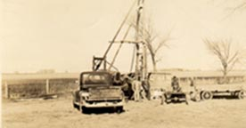 Sepia toned photo of cable tool drilling rig